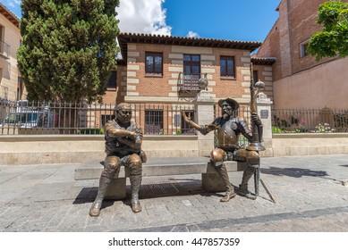 Alcala de Henares, Spain - June 13, 2016:  Statues of Don Quixote de la Mancha and Sancho Panza in front of house of the famous spanish writer Miguel de Cervante