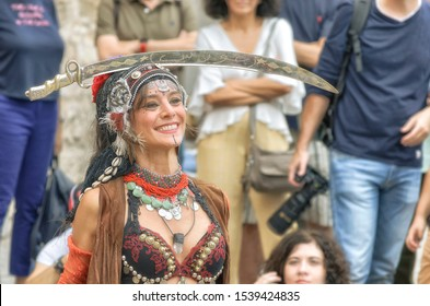 ALCALA DE HENARES, SPAIN - OCTOBER 12th 2019: Sacred dances. Neftis. Beautiful woman dancing with a saber over her head, in San Diego square, during the week of cervantino medieval street market
