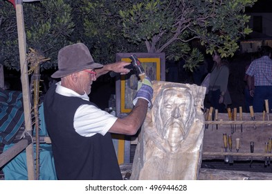 ALCALA DE HENARES, SPAIN - OCTOBER 8th 2016: Wood carver is doing a sculpture of Miguel de Cervantes, during Cervantino's market, in Alcala de Henares city, on October 8th 2016.