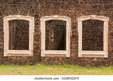 Alcantara, Maranhao, Brazil - May 20, 2016: Windows of the Baron Pindare's Palace (Palácio do Barão Pindaré) ruins, heritage site of the colonial city of Alcantara