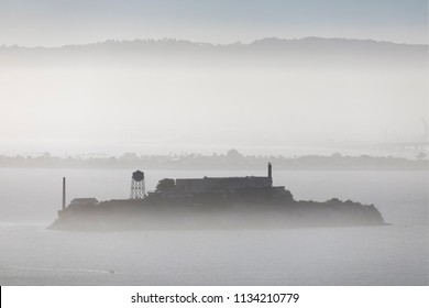 Alcatraz, in infamous prison of an island of the same name is viewed from afar in a foggy San Franciso Bay.