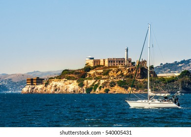 Alcatraz island with prison and yacht in San Francisco bay, California, USA