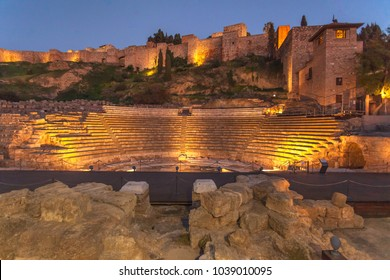 Alcazaba, the fortress palace (citadel) with ruins of roman theater in foreground, Malaga, Spain