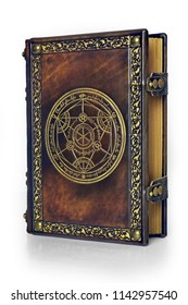 Alchemy leather book with gilded transmutation circle attributed to a German alchemist from the 17th century. The book is captured little from the right side, isolated while stand up on the table.