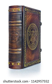 Alchemy leather book with gilded transmutation circle in center of the front cover, attributed to a German alchemist from the 17th century. Captured isolated while stand on the table from left side