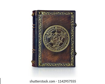 Alchemy leather book with gilded transmutation circle attributed to a German alchemist from the 17th century. The book is captured frontal, isolated while stand up on the table.