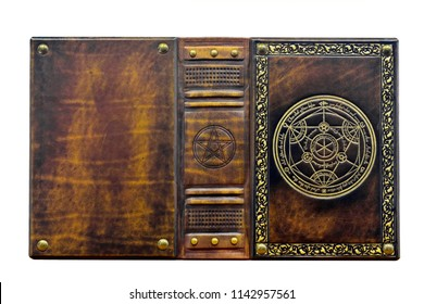 Alchemy leather book with gilded transmutation circle in center of the front cover, attributed to a German alchemist from the 17th century. Captured isolated and opened