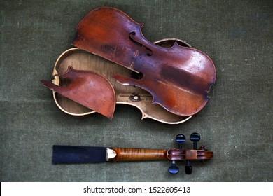 Alchevsk / Ukrain 09.04.19: Broken old violin lying awaiting repair