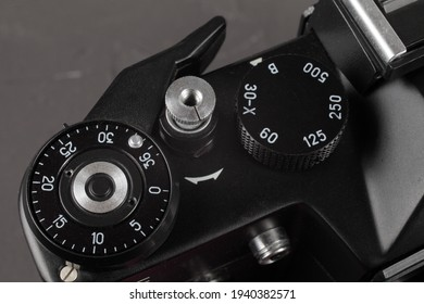 Alchevsk Ukrain - 19 March 2021: Old film SLR camera, shutter cocking wheel, frame counter and shutter button, close-up, selective focus
