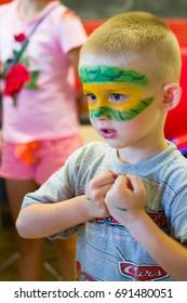 Alchevsk, Ukraine - July 27, 2017: Children's body painting with paints