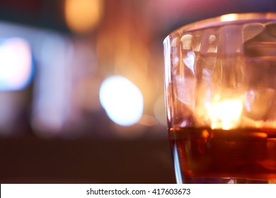 alchohol glasses with a background of neon lights and bokeh