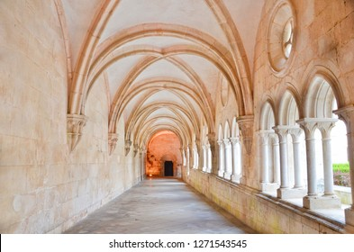 Alcobaca, Portugal - Sep 5th 2018: Beautiful corridors with arch Windows separated by columns in the inner courtyard in the Alcobaca Monastery. The cloister was the first Gothic building in Portugal.