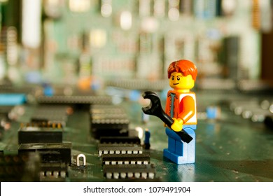 Alcobendas, Madrid, Spain April 14, 2018. Operator repairing an electronic board. Lego minifigures are manufactured by The Lego Group.