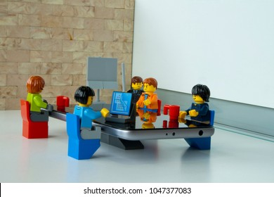 Alcobendas, Madrid, Spain. March 9, 2018. Image of business people working at meeting, Lego minifigures are manufactured by The Lego Group.