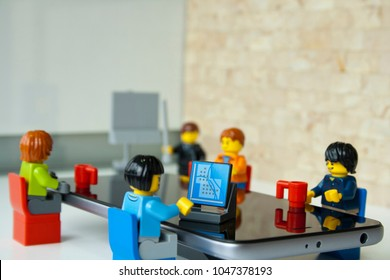 Alcobendas, Madrid, Spain. March 9, 2018. Image of business people working at meeting. Focus on the workers. Lego minifigures are manufactured by The Lego Group.