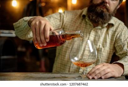 Alcohol addiction. Bearded man drinking alcohol. Whisky, brandy or cognac concept. Serious sad man having alcohol addiction. Addiction recovery, psychologist