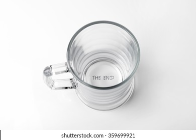"""alcohol addiction concept - empty glass with """"the end"""" text on the bottom"""