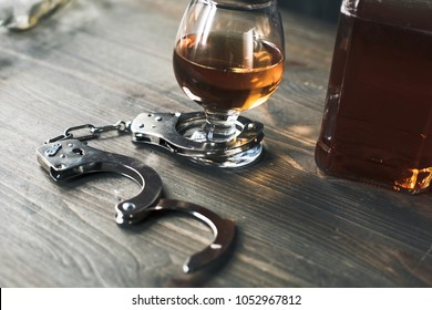 Alcohol addiction objects isolated on wooden table glass of whiskey close-up