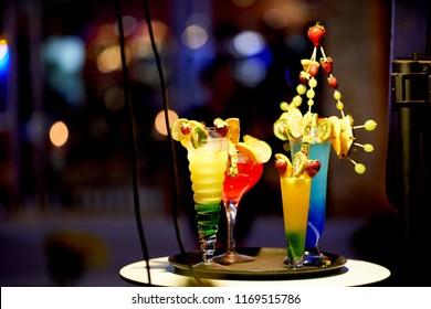 Alcohol bar, cocktail glass on bar counter, cocktail glass in a bar, Drinking cocktails, Fresh drink coctail on a color background night