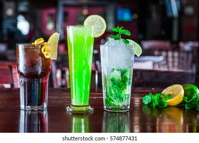 Alcohol bar, cocktail glass on bar counter, cocktail glass in a bar, Drinking cocktails, Fresh drink coctail on a color background