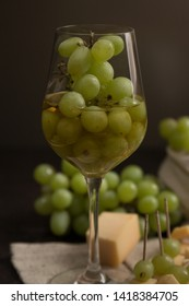 alcohol beverage with cheese and grape