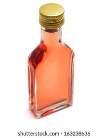 Alcohol bottle on white background