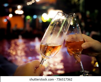 alcohol cheers clink glasses of sparkling wine in hand at night party