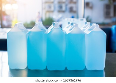 Alcohol for cleaning and sanitizing is contained in gallons in the warehouse. Many gallon alcohol gel for sanitizing Coronavirus Covid-19. Products for sale to anti Coronavirus protection (Covid 19).