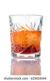 Alcohol cocktail negroni with orange ice ball and whiskey, close-up, isolated on white background
