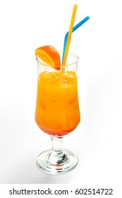 Alcohol cocktail in orange with ice and orange slice in a wide glass with tubules on a white background