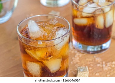 Alcohol cocktail of rum or whiskey with ice, copy space