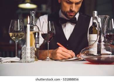 Alcohol critic writing his recommendation