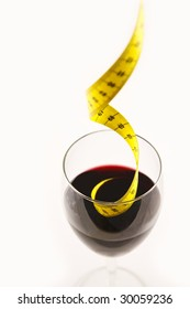 Alcohol and diet, a measuring tape drowning  in a glass of wine