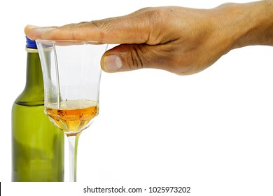 alcohol drinking with hand over drinking glass stock photo