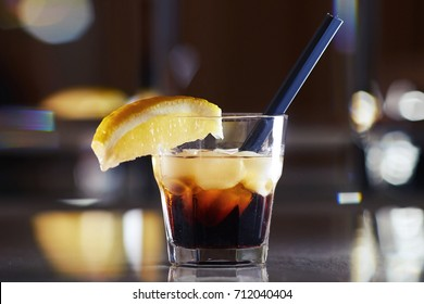 Alcohol. Drinks Boozy Black Russian cocktail with vodka and coffee liquor on a mirror background. copy space