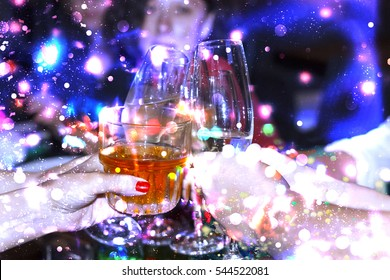 alcohol in glasses in the hands of the people. group of young people celebrating birthday, New Year, holiday