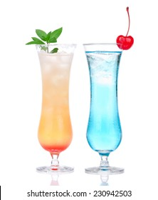 Alcohol margarita mai tai cocktail and blue hawaian Iced tea with maraschino cherry and mint cocktails isolated on a white background
