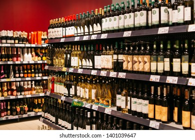 Alcohol market. Shelves with different wine bottles. Braila, Romania - May 2019