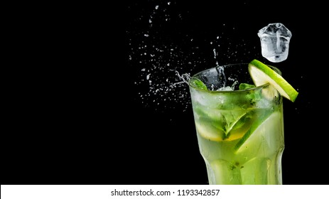 Alcohol mojito cocktail splash with mint and ice on black background