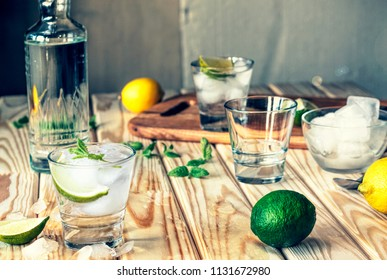 alcohol, Mojito with mint and ice slices on a wooden table in the bar, vodka, gin, tequila, rum, close up