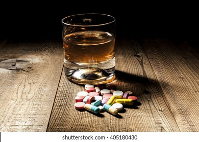 Alcohol and pills with shadow and little black background