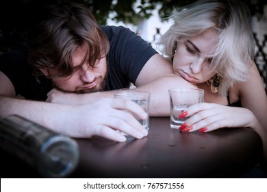 Alcohol problems in intimate relationships, families and marriages. Alcoholism in young adults. (pain, pity, hopelessness, social problem of dependence, depression concept)