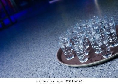 alcohol in shot glasses on a tray
