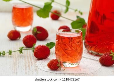 Alcohol strawberry drink in glass. Homemade strawberry liquor