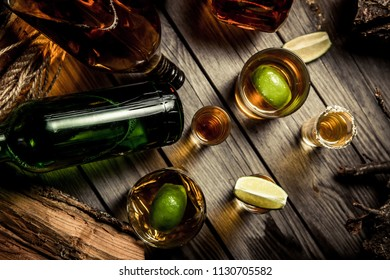 A lot of alcohol, whiskey, tequila, bourbon, brandy, rum on a wooden bar counter, vintage photo