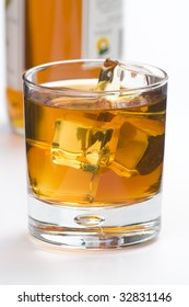 alcoholic beverage whith ice cubes isolated over white