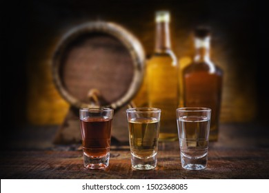 alcoholic beverages, cachaça, drips, rum and brandy. Selection of strong and hard alcoholic drinks, glasses. Vodka, brandy, tequila, brandy and whiskey, grappa, liqueur, vermouth, tincture, rum.