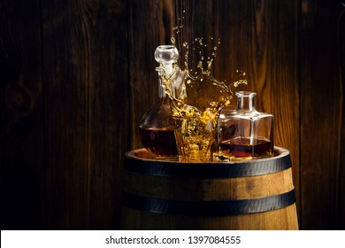 alcoholic beverages in glasses with a glass carafe on the barrel