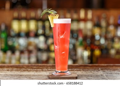 "Alcoholic cocktail on the basis of gin, cherry, orange and liqueur ""Benediktin"", grenadine, pineapple and lemon juice with the addition of bitter Angostura."