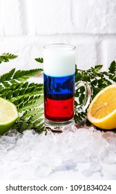 alcoholic cocktail russian flag on the background of a white concrete wall
